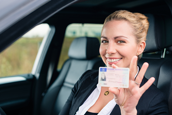 An image of a woman who has her driving licence